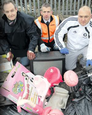 Andy Bate, Translink Group environmental manager (centre), with Robin Cathcart (left) and Darran Smyth from Parkhall Community Association during the Antrim railway line clean-up