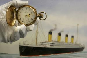 A gold plated Waltham American pocket watch, the property of Carl Asplund, is seen in front of a modern water colour painting of the Titanic by CJ Ashford at Henry Aldridge and Son auctioneers in Devizes, Wiltshire, England Thursday, April 3, 2008. The locket and one of the rings were recovered from the body of Carl Asplund who drowned on the Titanic, they are all part of the Lillian Asplund collection of Titanic related items.