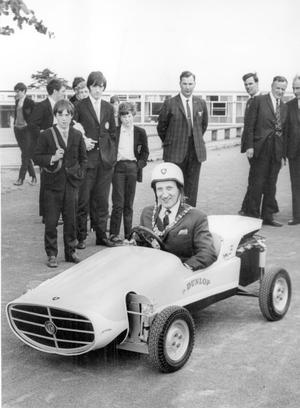 The Lord Mayor Alderman Joseph Cairns at the controls of the T.K.1., a car built by fourth year boys at Dunlambert Secondary School, Belfast after presenting road safety prizes at the school. The car which is powered by a 125 cc engine cost £30 to build, 1969.