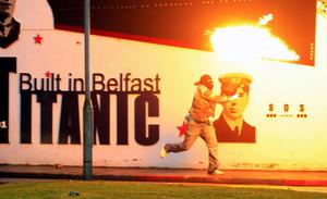 Loyalist rioters throw petrol bombs towards the mainly Catholic Short Strand area of East Belfast, Northern Ireland, Tuesday, June, 21, 2011.  Northern Ireland police faced a second night of attacks from rioters in east Belfast Tuesday, where sectarian rioting saw two people shot and homes attacked with gasoline bombs the previous night.   (AP Photo/Peter Morrison)