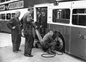 Riots : Belfast. August 1969.  Belfast Corporation workmen inflate the tyres of one of the buses which was taken from the depot at Ardoyne and used to block streets in the area.  More than 20 buses have been recovered to date.  (18/8/69)