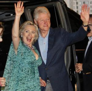 Bill and Hillary Clinton arrive for a party in honor of Chelsea Clinton and Marc Mezvinsky