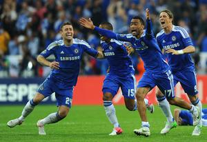 MUNICH, GERMANY - MAY 19: (L-R) Gary Cahill, Florent Malouda, Jose Bosingwa and Fernando Torres of Chelsea celebrate after Didier Drogba scored the winning penalty during UEFA Champions League Final between FC Bayern Muenchen and Chelsea at the Fussball Arena München on May 19, 2012 in Munich, Germany.  (Photo by Mike Hewitt/Getty Images)