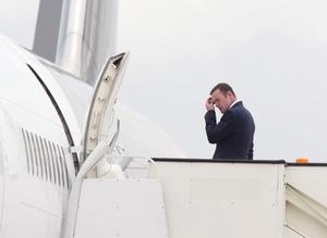 England's Wayne Rooney boards a plane at Luton Airport as the England team depart for their Euro 2012 base in Krakow