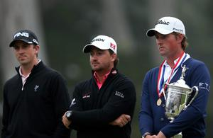 SAN FRANCISCO, CA - JUNE 17:  Webb Simpson of the United States (R) poses the trophy as Graeme McDowell of Northern Ireland (C) and Michael Thompson of the United States (L) look on after Simpson's one-stroke victory at the 112th U.S. Open at The Olympic Club on June 16, 2012 in San Francisco, California.  (Photo by Ezra Shaw/Getty Images)