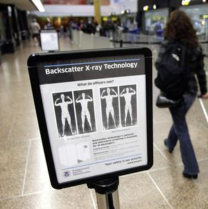 A sign informing travellers about the use of full-body scanners at Seattle-Tacoma International Airport in Seattle (AP)