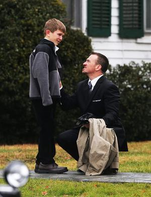 NEWTOWN, CT - DECEMBER 17:  A man comforts a boy outside Honan Funeral Home before the funeral for 6-year-old Jack Pinto on December 17, 2012 in Newtown Connecticut. Pinto was one of the 20 students killed in the Sandy Hook Elementary School mass shooting.  (Photo by Mario Tama/Getty Images) *** BESTPIX ***