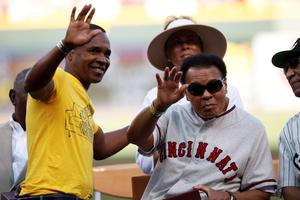 Former boxing champion Sugar Ray Leonard (L) looks on after presenting the Major League Baseball Beacon Award to former heavyweight boxing champion Muhammad Ali prior to the Gillette Civil Right Game between the Cincinnati Reds and Chicago White Sox at Great American Ball Park on June 20, 2009 in Cincinnati, Ohio.