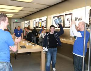 The first customer in Northern Ireland Steven Wilkinson leaves the Apple store in Victoria Square, Belfast with his new Ipad.