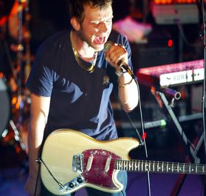 British rock band Blur lead singer Damon Albarn performs at the Bowery Ballroom March 16, 2003 in New York City