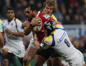 CLERMONT-FERRAND, FRANCE - JANUARY 21:  John Afoa of Ulster is tackled during the Heineken Cup match between ASM Clermont Auvergne and Uster at Stade Marcel Michelin on January 21, 2012 in Clermont-Ferrand, France.  (Photo by Tom Shaw/Getty Images)