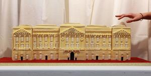 LONDON, ENGLAND - APRIL 21:  A cake of Buckingham Palace is displayed at an exhibition of Royal Wedding cakes on April 21, 2011 in London, England. The cake features in the 'Let Them Eat Cake' exhibition inside Wellington Arch on Hyde Park Corner and is open to the public over Easter from April 22-25, 2011.  (Photo by Oli Scarff/Getty Images)
