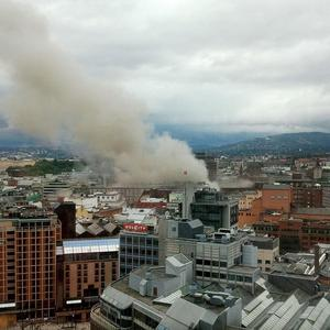 Smoke rises from central Oslo after an explosion ripped through government buildings (AP/Scanpix)