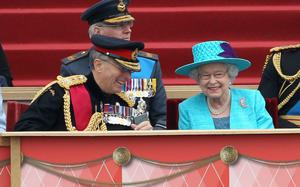 WINDSOR, ENGLAND - MAY 19:  Queen Elizabeth II shares a joke with Chief of the Defence Staff General Sir David Richards (L) at Home Park on May 19, 2012 in Windsor, England. Over 2500 troops took part in the Diamond Jubilee Muster in Home Park.  (Photo by Chris Jackson - WPA Pool/Getty Images)