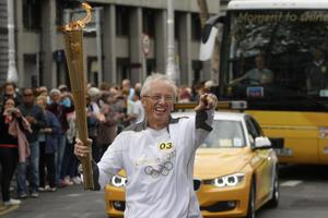 Olympic medalist John Treacy carrying the Olympic Flame on the Torch Relay leg through Dublin