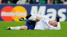 Wayne Rooney lies on the Allianz Arena turf after landing badly on his right ankle