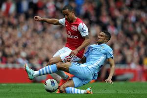 LONDON, ENGLAND - APRIL 08:  Gael Clichy of Man City tackles Theo Walcott of Arsenal during the Barclays Premier League match between Arsenal and Manchester City at Emirates Stadium on April 8, 2012 in London, England.  (Photo by Michael Regan/Getty Images)