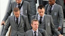 England coach Stuart Pearce (bottom) John Terry (centre, right), Matthew Upson (centre, left), Jermain Defoe (top, right) and fitness coach Massimo Neri arrive at Heathrow Airport, London. The England team returned to the UK after a 4-1 defeat to Germany in the Round of 16 match in Bloemfontein, South Africa on Sunday