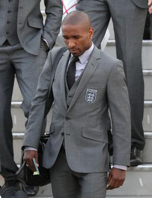 England's Jermain Defoe arrives at Heathrow Airport, London.  The England team returned to the UK after a 4-1 defeat to Germany in the Round of 16 match in Bloemfontein, South Africa on Sunday