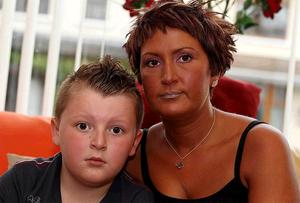Nine-year-old Ben White with his mum Amanda in their home at Woodvale Gardens