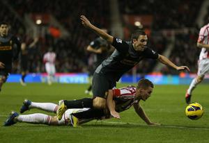 STOKE ON TRENT, ENGLAND - DECEMBER 26:  Ryan Shawcross of Stoke City tangles with Stewart Downing of Liverpool during the Barclays Premier League match between Stoke City and Liverpool at the Britannia Stadium on December 26, 2012, in Stoke-on-Trent, England.  (Photo by Bryn Lennon/Getty Images)