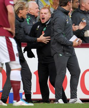 Celtic's Neil Lennon celebrates the opening goal during the Clydesdale Bank Scottish Premier League at Tynecastle Stadium, Edinburgh