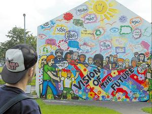 Free Derry Corner, which was dramatically covered by a mural on Saturday to mark the city's annual Gasyard Feile