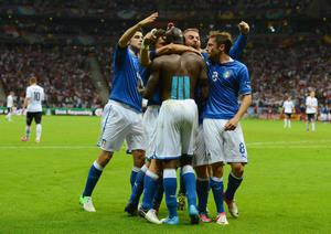 WARSAW, POLAND - JUNE 28:  Mario Balotelli (C) of Italy celebrates with team-mates after scoring his team's second goal during the UEFA EURO 2012 semi final match between Germany and Italy at the National Stadium on June 28, 2012 in Warsaw, Poland.  (Photo by Shaun Botterill/Getty Images)