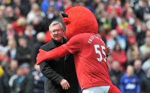 Manchester United manager Sir Alex Ferguson with mascot Fred the Red during the Barclays Premier League match at Old Trafford, Manchester