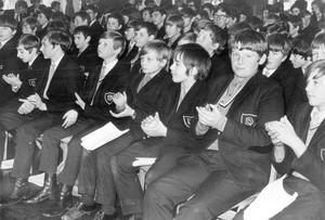 Prize-winners applaud the guest speaker, Dr. N. A. Burges, vice-chancellor of the New University of Ulster, during the prize distribution at Dunlambert Secondary School, Belfast, 1971.