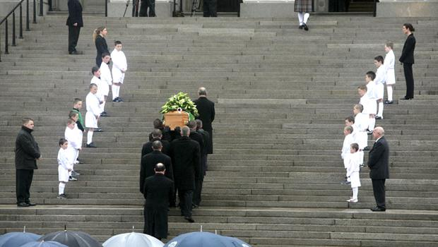 George Best's coffin is carried up the steps to the Stormont buildings