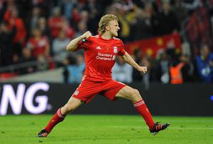 Liverpool's Dirk Kuyt celebrates scoring his penalty in the shoot-out during the Carling Cup Final at Wembley Stadium, London.