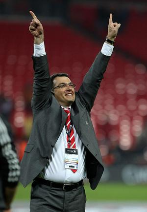 Liverpool Director of Football Damien Comolli celebrates after the game during the Carling Cup Final at Wembley Stadium, London.
