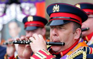 In flull flow, a flautist from Armadale Flute Band, Scotland plays a merry tune as he parades the Twelfth through Lurgan. Picture By Rick Hewitt. 12/7/11.