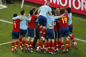 Spain players celebrate winning the penalty shootout of  the Euro 2012 soccer championship semifinal match between Spain and Portugal in Donetsk, Ukraine, Thursday, June 28, 2012. (AP Photo/Darko Vojinovic)