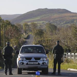 Police cordon off roads near the scene where a helicopter crashed in the Mourne Mountains