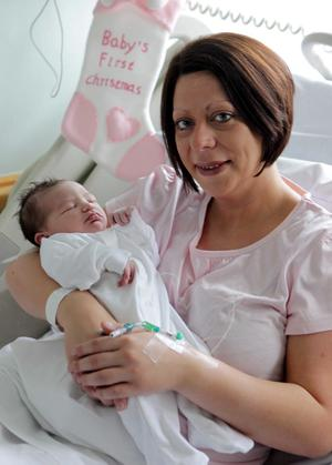 Louise Moore from Loughbrickland pictured in the Ulster Hospital along with Christmas Day arrival baby girl Caomhe who was born at 0421 weighing