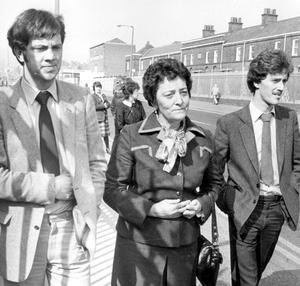 Mrs Campbell, widow of murdered RUC Sergeant, Joseph Patrick Campbell, leaving a court in Belfast in 1982 with her two son, Thomas (left) and Joseph