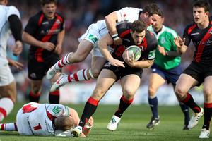 DUBLIN, IRELAND - APRIL 28:  Tom Visser of Edinburgh is tackled during the Heineken Cup semi final match between Ulster and Edinburgh at Aviva Stadium on April 28, 2012 in Dublin, Ireland.  (Photo by Clive Rose/Getty Images)
