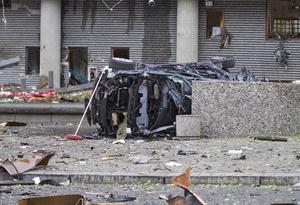 The wreckage of a car lies outside a building in the centre of Oslo, Friday July 22, 2010, following an explosion that tore open several buildings including the prime minister's office, shattering windows and covering the street with documents and debris. A loud explosion shattered windows Friday at the government headquarters in Oslo which includes the prime minister's office, injuring several people.  Prime Minister Jens Stoltenberg is safe, government spokeswoman Camilla Ryste told The Associated Press