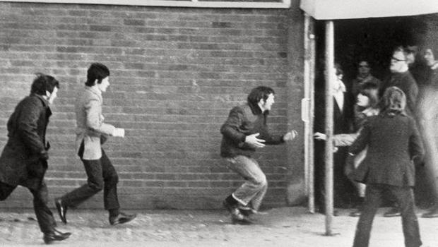 Hugh Gilmore (third left) seen clutching his stomach as he is shot during Bloody Sunday.