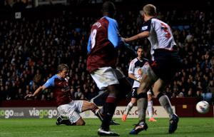 BIRMINGHAM, ENGLAND - APRIL 24:   Stephen Warnock of Aston Villa  scores the opening goal during the Barclays Premier League match between Aston Villa and Bolton Wanderers at Villa Park on April 24, 2012 in Birmingham, England. (Photo by Michael Steele/Getty Images)