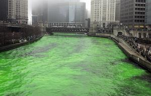 Thousands of spectators watch as the Chicago River is dyed green prior to the annual St. Patrick's Day parade
