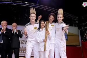 Sonia O'Sullivan posing for a photograph with torchbearers 007 John (left) and Edward Grimes aka Jedward after the lighting of the cauldron at St Stephen's Green in Dublin