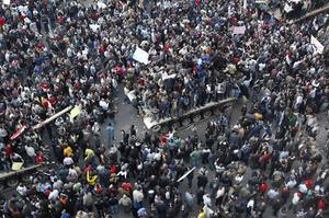 In this photo released by China's Xinhua news agency, demonstrators gather near the main Tahrir Square in Cairo, Egypt, on Saturday Jan. 29, 2011. Thousands of anti-government protesters have returned to Cairo's central square, chanting slogans against Hosni Mubarak just hours after the Egyptian president fired his Cabinet but refused to step down. (AP Photo/Xinhua, Cai Yang) NO SALES