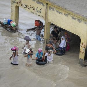 Victims of the floods wait to be evacuated in Sanawan near Multan in central Pakistan (AP)