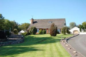 """<b>23. Drumadravy, Irvinestown, Irvinestown, Fermanagh, BT94 1LQ For Sale From £1,000,000</b> Turning-Point Property Sales are thrilled to bring to the market this magnificent 4/5 bedroom chalet bungalow with possibility to convert rooms to a 1 bedroom """"granny flat"""" situated on the edge of Lisnarick.   A unique property in today's market it has a rear courtyard with 6 large stables, tack room and 2 garages as well as a commercial yard and 3.5 acres of agricultural land.  <p><b>To view property <a href=""""http://www.propertynews.com/Property/Irvinestown/PNC250453/Drumadravy/194686923/Page7"""" title=""""Click here to view property"""">Click here</a> </a></p></b>"""