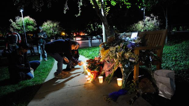 CUPERTINO, CA - OCTOBER 05:  People light candles at a makeshift memorial for Steve Jobs at the Apple headquarters on October 5, 2011 in Cupertino, California. Jobs, 56, passed away after a long battle with pancreatic cancer. Jobs co-founded Apple in 1976 and is credited, along with Steve Wozniak, with marketing the world's first personal computer in addition to the popular iPod, iPhone and iPad.  (Photo by Kevork Djansezian/Getty Images)
