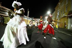SALVADOR, BRAZIL - FEBRUARY 16: Performers dance on the first day of Carnival celebrations on February 16, 2012 in Salvador, Brazil. Carnival is the grandest holiday in Brazil, annually drawing millions in raucous celebrations culminating on Fat Tuesday before the start of the Catholic season of Lent which begins on Ash Wednesday. Salvador is the capital of the Northeastern state of Bahia and was the first colonial capital of Brazil. Police strikes in Salvador and Rio de Janiero in recent weeks threatened Carnival and raised questions about the countryÄôs preparedness to host the upcoming 2014 World Cup and 2016 Summer Olympics. Rio de JanieroÄôs Carnival begins tomorrow.   (Photo by Mario Tama/Getty Images)