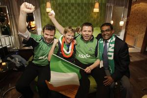 Ireland cricketer Kevin O'Brian's (left to right) brother Conor, sister in law Aiofe, brother Gerard and club mate Rangan Arulchelvan celebrates Ireland's victory over England in their ICC Cricket World Cup match, during a post match party at Krystal night Club, Dublin